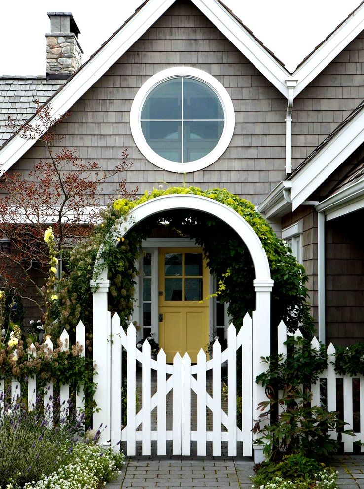 Pickett Fences   Victorian Landscape  and Archway Climbing Plants Entry Gate Front Door Lavender Northwest Shingle Style Round Window Shingle Roof Shingle Siding Stone Chimney White Gate White Picket Fence White Window Trim Yellow Door