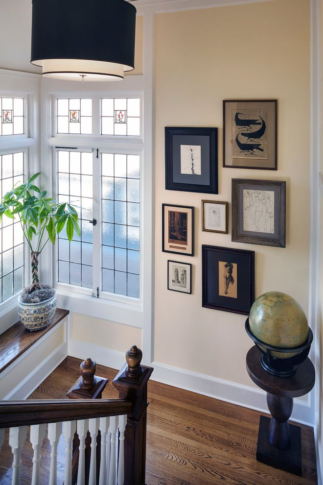 Picture Frames 9x12 with Traditional Staircase Also Beige Wall Built in Bench Corner Window Framed Artwork Gallery Wall Globe Medium Wood Bench Top Medium Wood Flooring Pendant Light White Railing White Trim