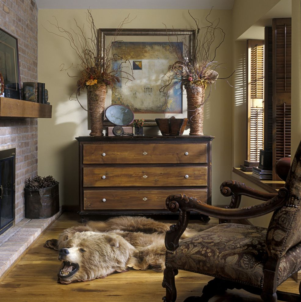 Picture of a Teddy Bear   Eclectic Family Room Also Arm Chair Art Bear Rug Brick Carved Wood Dark Stained Wood Dresser Fireplace Mantel Wood Floor Wood Mantle Wood Shutters