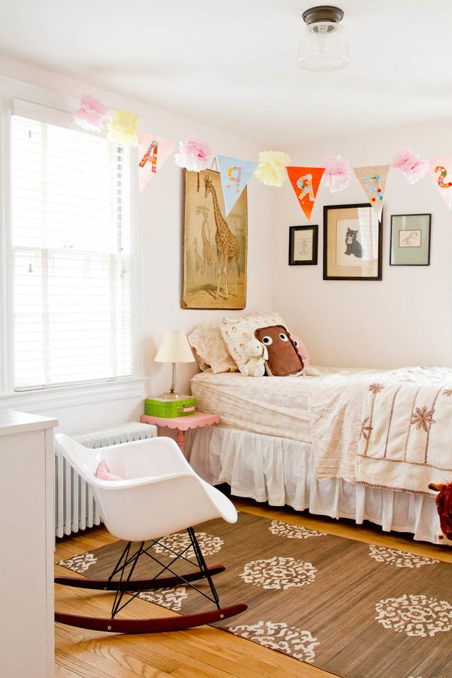 Picture of a Teddy Bear   Shabby Chic Style Kids Also Animal Artwork Banner Brown Patterned Rug Eames Rocking Chair Floral Bedding Giraffe Wall Art Light Pink Floor Name Banner Paper Banner Pink Nightstand White Rocking Chair Wood Floor