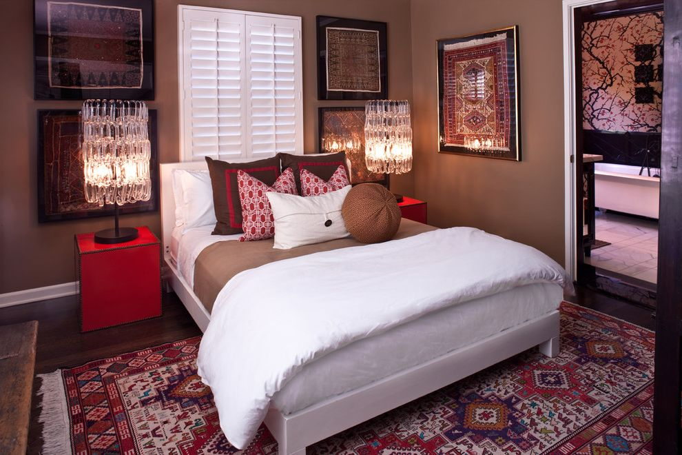 Picture of a Teddy Bear with Transitional Bedroom Also Accent Pillows Brown Chandelier Lamps Hardwood Floors Oriental Rug Plantation Shutters Platform Bed Red Accent Colors Red Side Tables White Upholstered Headboard
