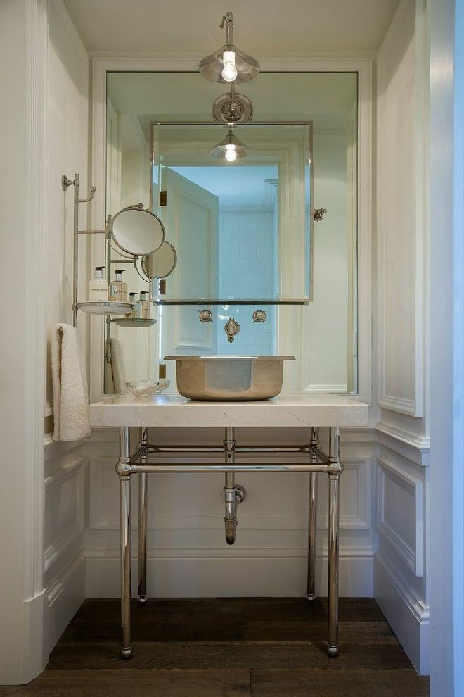 Pier One Wall Mirrors   Mediterranean Powder Room  and Makeup Mirror Metal Sink Wall Mounted Faucet Wall Sconce White Countertop White Wall Paneling