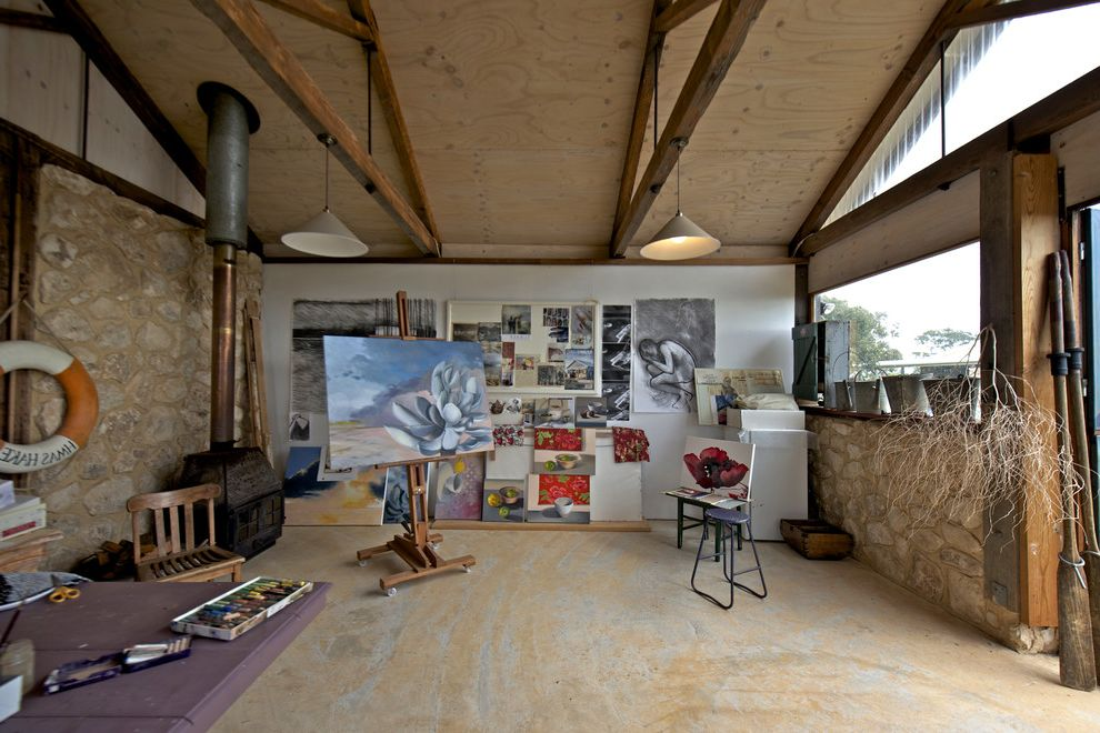 Pilates Room Studios   Rustic Home Office  and Art Artisit Studio Combustion Fire Country Easel Exposed Beams Life Preserver Paintings Pendant Lights Plywood Ceiling Rustic Stone Wall Stone Walls Trusses Wood Stove