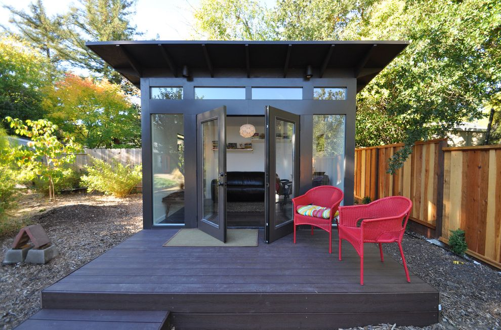 Pilates Room Studios with Modern Shed  and Artists Studio Black Exterior Deck Door Mat Floor to Ceiling Windows Home Office Modern Modern Shed Pendant Light Prefabricated Shed Red Chairs Row of Windows Shed Studio Studio Shed Trees Wood Fence