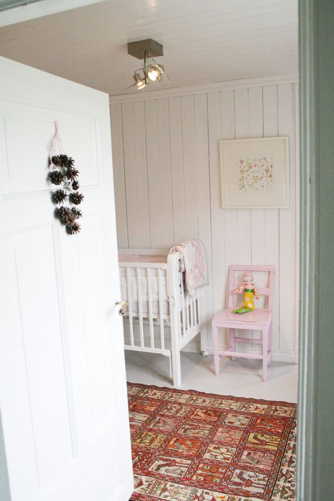 Pine Cone Lumber   Scandinavian Nursery Also Area Rug Ceiling Lighting Distressed Finish Kids Chair Nursery Pinecone Wreath Rustic White Floor White Wood Wood Ceiling Wood Paneling Wood Trim Wood Trin Wooden Crib
