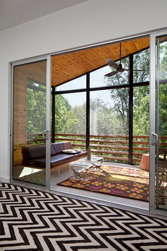 Pine Street Equinox with Contemporary Porch Also Black and White Rug Brown Sofa Knotty Wood Patio Doors Screened Porch Sliding Doors Sliding Glass Door Three Blade Ceiling Fan Waterfall Table Wood Slat Fence Wood Soffit Lining Zigzag Rug