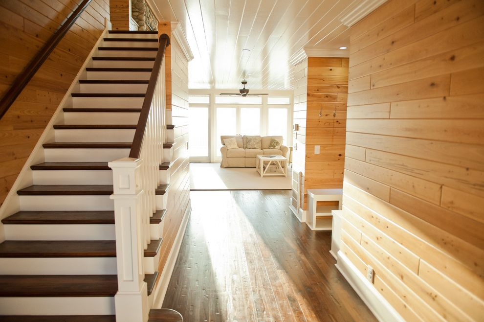 Pine Street Equinox with Traditional Staircase  and Ceiling Fan Dark Stained Treads Seating Area Area Rug Staircase Tonge and Groove Ceiling Tongue and Groove Paneling White Painted Wood Ceiing Wood Floor