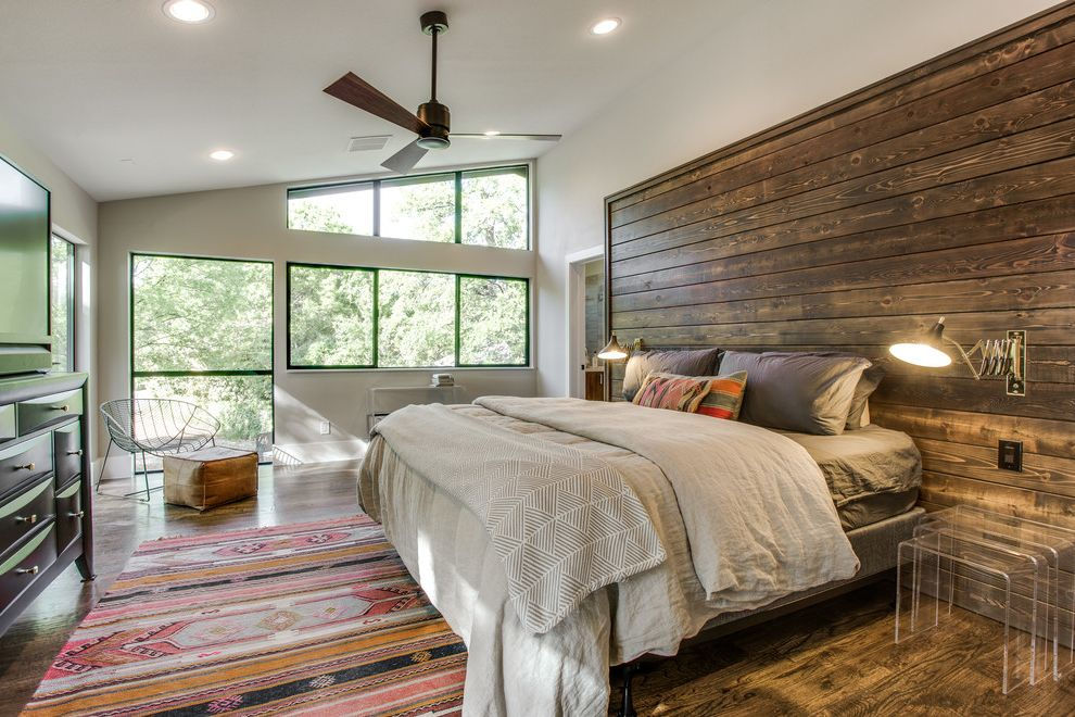 Pink Aztec Rug with Southwestern Bedroom  and Aztec Pillow Black Window Trim Ceiling Fan Dark Wood Siding Gray Bedding Pink Aztec Rug Wire Butterfly Chair
