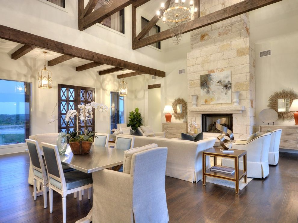Places to Visit in Austin with Transitional Living Room  and Armchairs Chandelier Dining Area Double Doors Sofa Tall Ceilings Wood Beams
