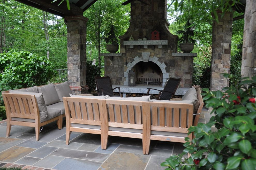 Plae Flooring with Traditional Patio Also Bluestone Covered Patio Fireplace Granite Mantel Outdoor Fireplace Outdoor Seating Patio Furniture Pavilion Seat Cushions Sectional Sofa Shrubs Sitting Area Stone Columns Teak Wood Sofa
