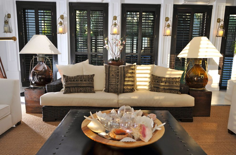 Plantation Shutters Costco   Tropical Living Room  and Black Shutters Lantern Wall Sconces Natural Fiber Area Rug Rustic Sea Shells Seat Cushions Side Tables Table Lamps White Wall Wicker Sofa
