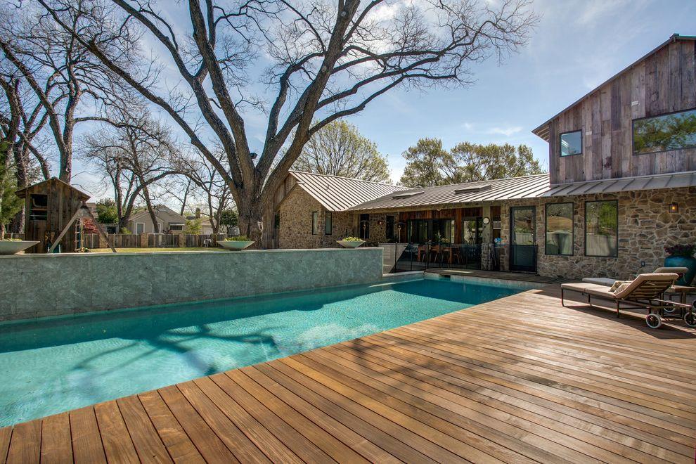 Playhouse Dallas   Farmhouse Pool  and Barn Barnwood Fence Ipe Metal Roof Pecan Tree Playhouse Pool Stone