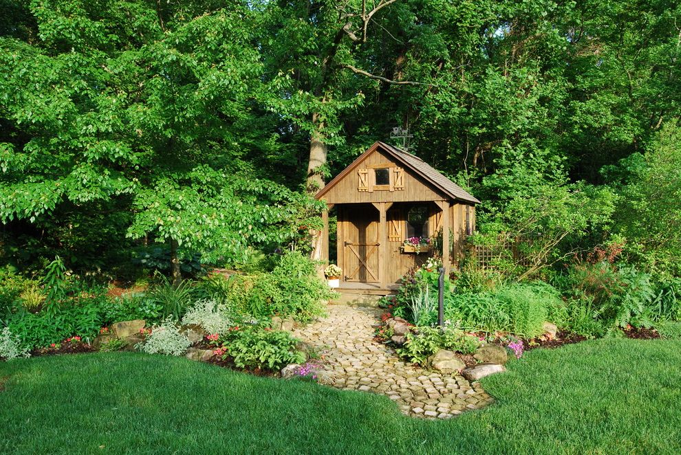 Playhouse Dallas with Rustic Shed  and Berm Covered Porch Dog House Natural Landscape Cobblestone Flower Box Garden Lattice Lawn Porch Rustic Stone Pavers Wood Siding
