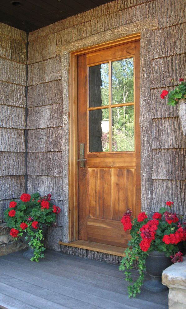 Plumber Boone Nc   Rustic Entry  and Bark Shingles Lap Siding Plant Urns Red Flowers Rustic Stained Wood Stone Work Wood Deck Wood Front Door Wood Trim