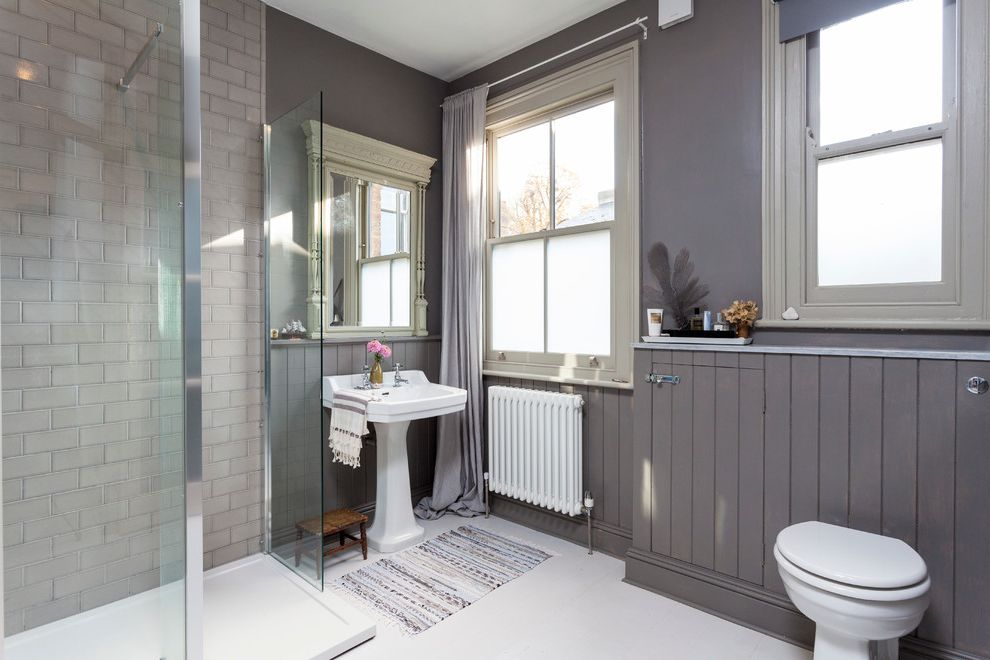 Plumbing Access Panel Lowes   Scandinavian Bathroom  and Framed Mirror Gray Curtains Gray Wainscoting Radiator Rag Rug Tankless Toilet