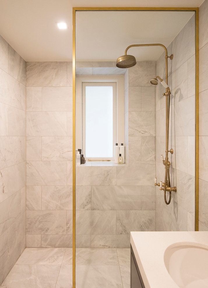 Polished Brass Shower Fixtures with Contemporary Bathroom Also Architecture Bathroom Bronze Fixtures Frosted Glass Window Gold Gold Frame Modern Bathroom Design Modern Design Renovation