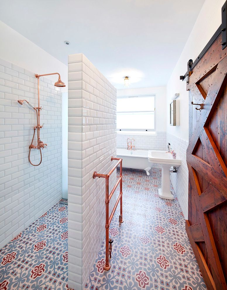 Polished Brass Shower Fixtures with Contemporary Bathroom Also Bathroom Floor Tile Bathroom Tile Brass Brass Fixtures Copper Copper Shower Copper Shower Fixture Hamilton Terrace Metro Tile Patterned Floor Tile Sliding Barn Door Threefold Architects