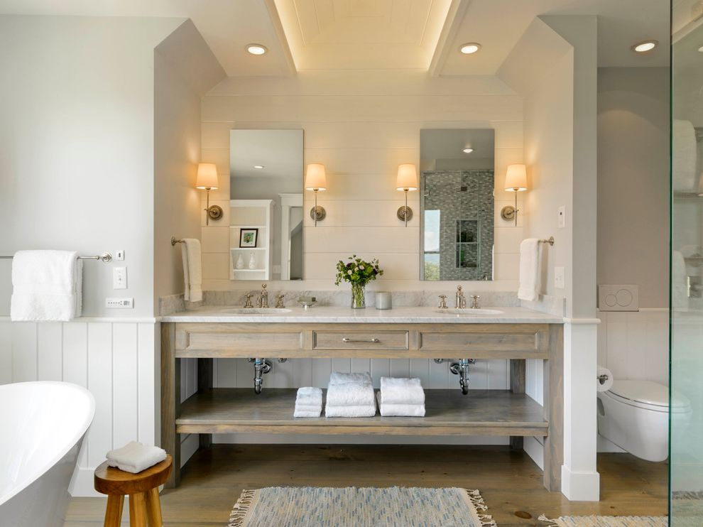 Polished Brass Vanity Lights with Farmhouse Bathroom  and Cove Lighting Distressed Wood Double Sinks Frameless Mirrors Light Wood Natural Light Recessed Lighting Shiplap Small Wooden Stool Towel Bar Two Sinks Wall Sconces
