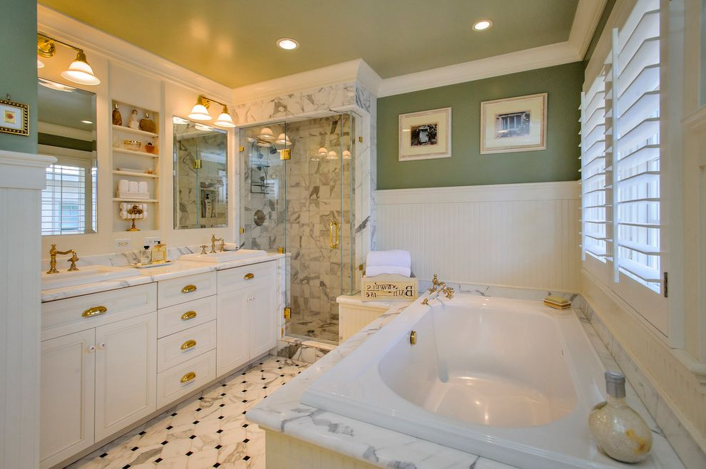 Polished Brass Vanity Lights with Traditional Bathroom Also Accent Ceiling Bathroom Lighting and Vanity Lighting Bathtub Beadboard Ceiling Lights Crown Molding Glass Shower Door Open Shelves Painted Wall Tile Floors Tile Shower Tub Deck Vanity