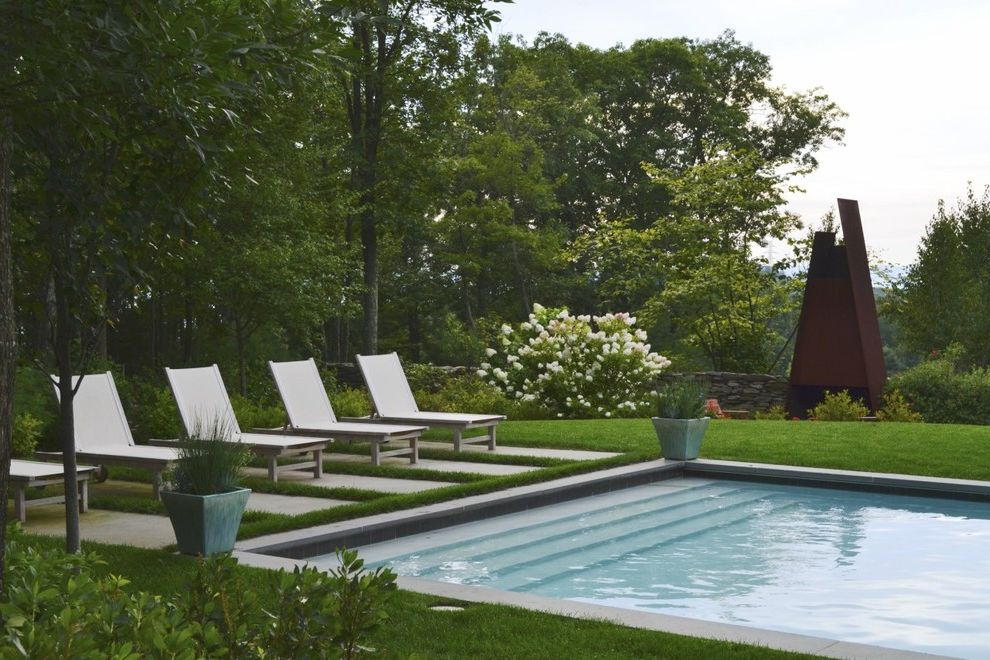 Pool Chaise Lounge Chairs Sale with Contemporary Pool Also Concrete Pavers Concrete Pool Grass Lawn Metal Sculpture Metal Statue Outdoor Chaise Lounge Outdoor Metal Sculpture Outdoor Metal Statue Outdoor Potted Plant Pool Pool Stairs White Flowers