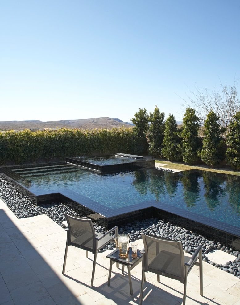 Pool Design Las Vegas   Contemporary Pool  and Black Tile Deco Desert Gray Armchair Landscaping Outdoor Furniture River Rocks
