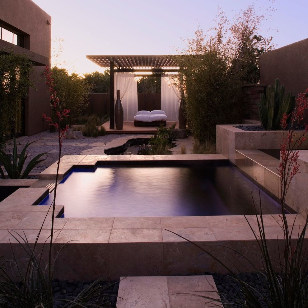 Pool Design Las Vegas with Contemporary Patio Also Gravel Large Urns Outdoor Bed Outdoor Curtains Partially Covered Patio Patio Curtains Water Feature Waterfall White Bedding White Curtains White Drapes
