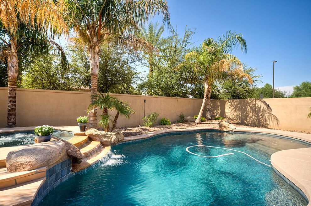 Pool Service Chandler Az   Mediterranean Pool  and Concrete Patio Hot Tub Hot Tub Waterfall Palm Tree Pool Pool Water Feature Pool Water Fountain Pool Waterfall Rock Hot Tub Rock Spa Spa Stucco Wall