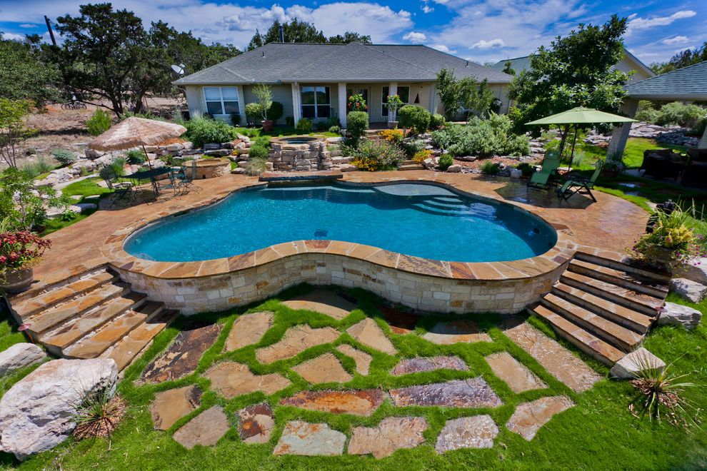 Pools in Mcallen Tx with Traditional Pool  and Boulders Disappearing Edge Pool Grass Grass Between Pavers Lawn Outdoor Steps Patio Furniture Patio Umbrella Pavers Rocks Stone Pool Deck Stone Wall Turf