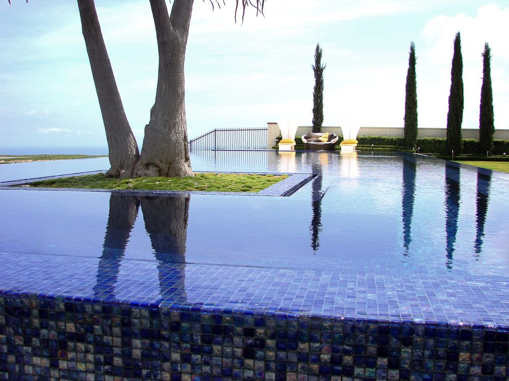 Pools in Staten Island with Mediterranean Pool  and Blue Cypress Disappearing Edge Pool Geometric Geometry Glass Tile Groundcover Hedge Infinity Pool Planter Tile View Wall Zero Edge Pool