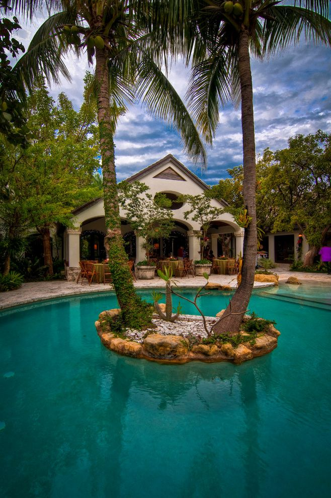 Pools in Staten Island with Mediterranean Pool  and Boulders Covered Patio Palm Trees Island Backyard Patio Paving Rocks