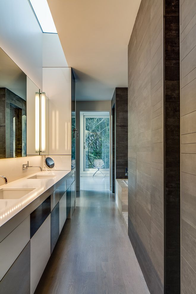 Porcelain Tile That Looks Like Marble   Modern Bathroom Also Double Sink Gray Floor Tile Makeup Mirror Minimalist Bathroom Open Doorway Rectangular Mirror Skylight Tub Deck Two Sinks Wall Sconces White Countertop