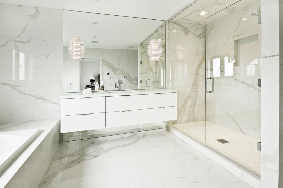 Porcelain Tile That Looks Like Marble with Modern Bathroom  and Black Windows Calcutta Drop in Tub Floating Vanity Large Porcelain Slabs Marble Floor Marble Walls Pot Lights Wall Mirrors Wall Sconces White Washroom