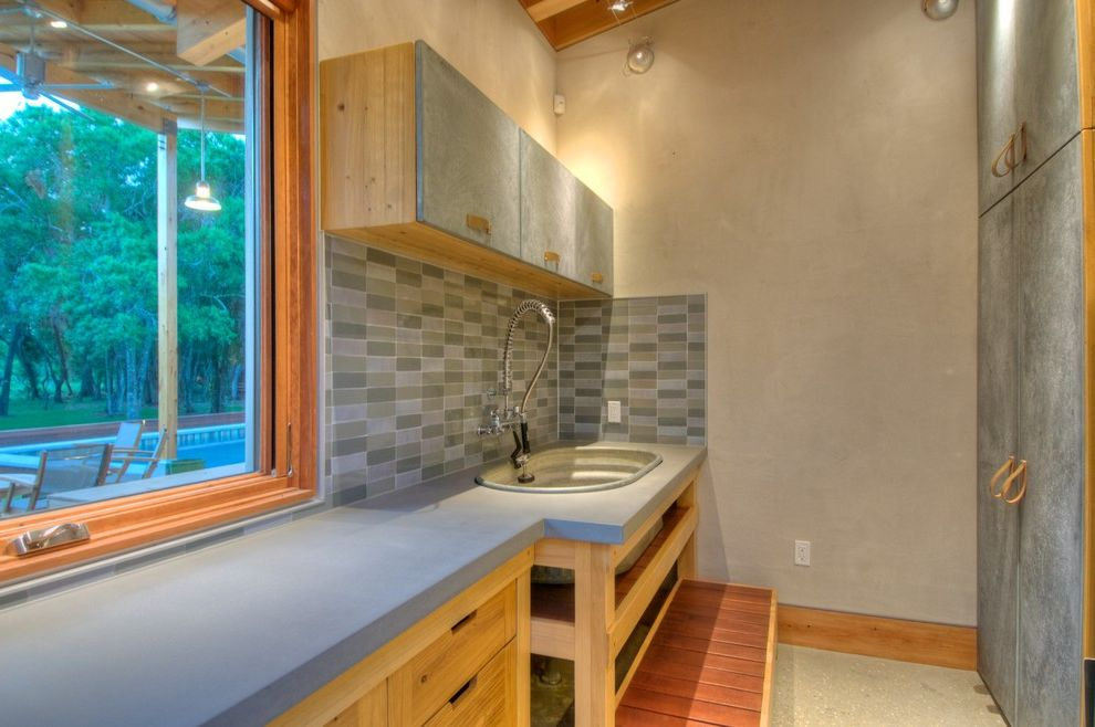 Portland Construction Companies   Modern Laundry Room  and Concrete Counters Concrete Floors Dog Room Flush Cabinets Galvanized Steel Leather Handles Mud Room Tile Backsplash Wood Trim