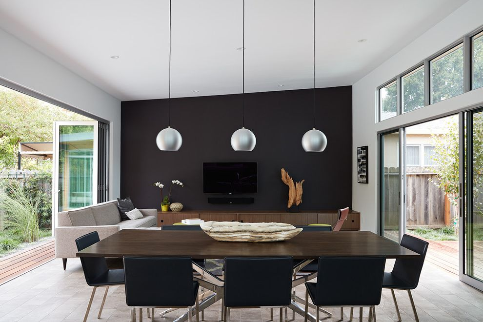 Positano San Carlos   Midcentury Dining Room Also Black Accent Wall Black Dining Chairs Dark Wood Dining Table Indoor Outdoor Pendant Light Slanted Ceiling