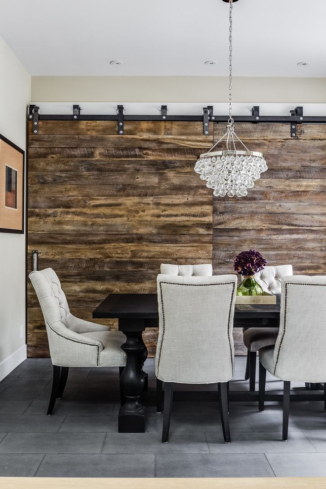 Positano San Carlos   Rustic Dining Room  and Barn Door Hardware Black Dining Table Crystal Chandelier Distressed Wood Farmhouse Gray Walls High Ceilings Reclaimed Wood Sliding Barn Doors Tufted Gray Dining Chair Upholstered Dining Chair