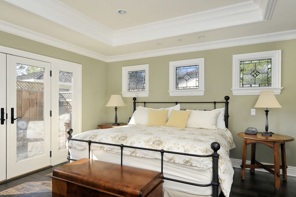 Positano San Carlos with Victorian Bedroom  and Baseboards Bedside Table Dark Floor Floral Duvet Foot of the Bed French Doors Glass Doors Leaded Glass Neutral Colors Nightstand Storage Chest Tray Ceiling Trunk White Wood Wood Trim Wrought Iron Bed