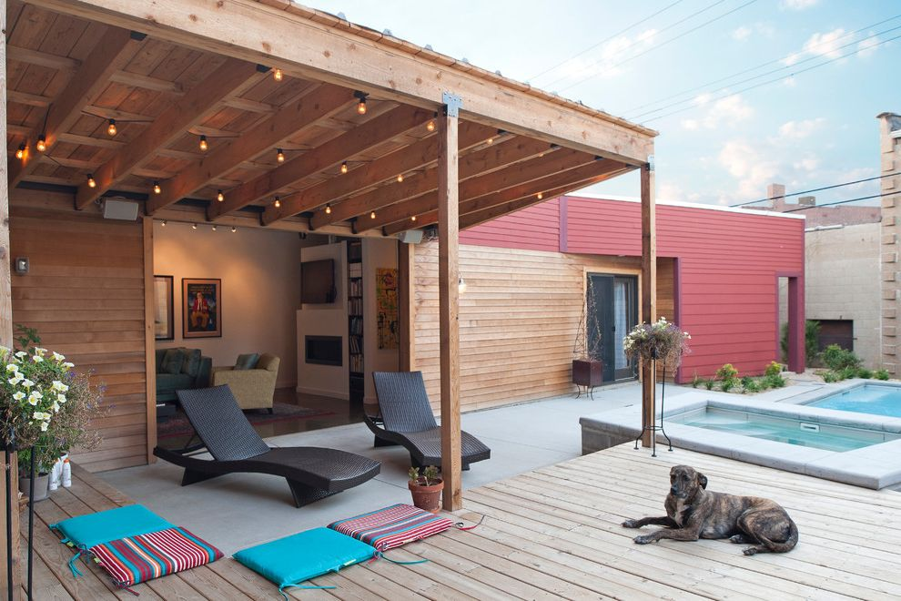 Post Community Credit Union with Contemporary Patio  and Concrete Patio Flat Roof Hottub Outdoor Chaise Lounge Outdoor Cushions Outdoor Planter Pergola Pool Red Siding Spa String Lights Wood Deck Wood Pergola Wood Siding