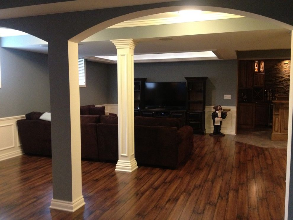 Poteau Theater with Traditional Basement  and Arch Finished Basement Wood Floor