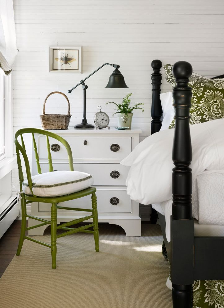 Pottery Barn Chair and a Half   Beach Style Bedroom  and Area Rug Bedside Table Four Poster Bed Green Chair Nightstand Shadow Box White Bedding White Trim Wood Bed Wood Paneling