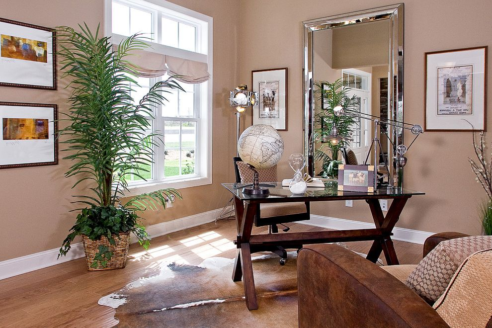 Pottery Barn Secretary Desk with Contemporary Home Office and Animal Hide Rug Brown Sofa Chair Fake Palm Tree Glass Desk Globe Light Brown Walls Roman Shades Sand Clock Tall Mirror White Trim