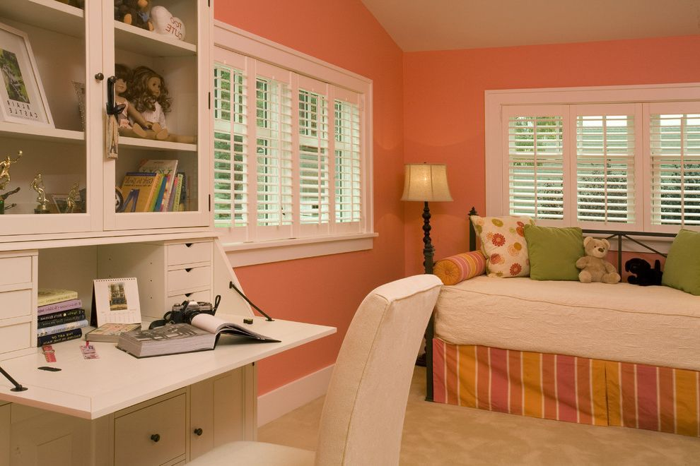 Pottery Barn Secretary Desk with Traditional Kids and Baseboards Bed Pillows Bedroom Day Bed Pink Walls Plantation Shutters Sloped Ceiling Vaulted Ceiling White Wood Window Treatments Wood Trim Wooden Desk Writing Secretary