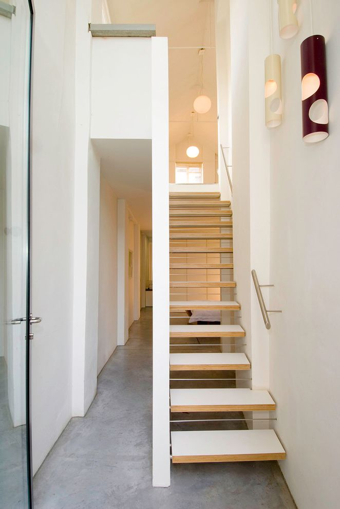 Poured Concrete Floors   Contemporary Staircase Also Banister Contemporary Staircase Narrow Hallways Narrow Staircase Open Staircase Open Tread Open Tread Staircase Pendant Lights Poured Concrete Flooring White Walls