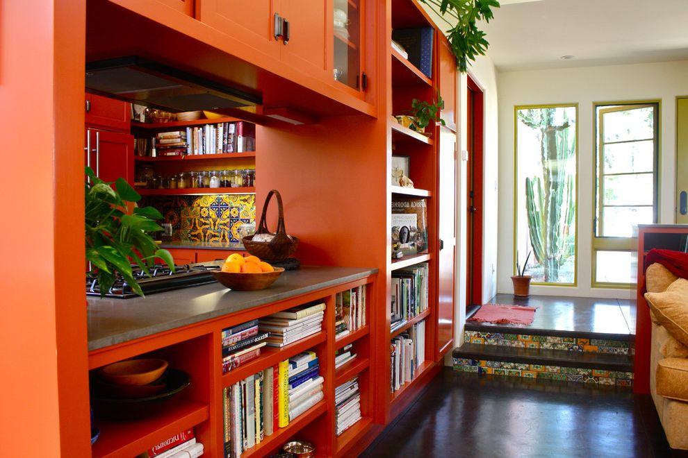Pratt and Lambert Paint Reviews   Southwestern Living Room  and Bookshelves Concrete Floor Entry Gray Counters Open Shelving Orange Cabinets Steps Tile Risers White Walls Yellow Window Trim