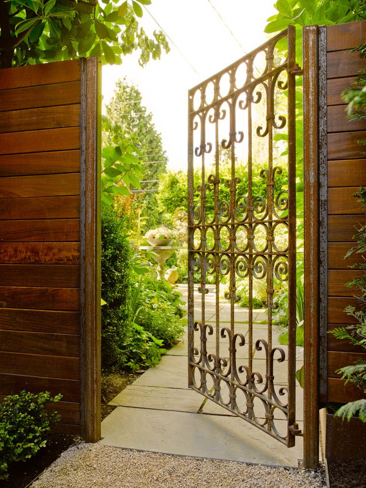 Pressure Mounted Dog Gates with Contemporary Patio  and Bronze Iron Gate Entry Gate Gravel Path Privacy Fence Side Yard Stone Pavers Tree Arch Wood Fence Wood Gate
