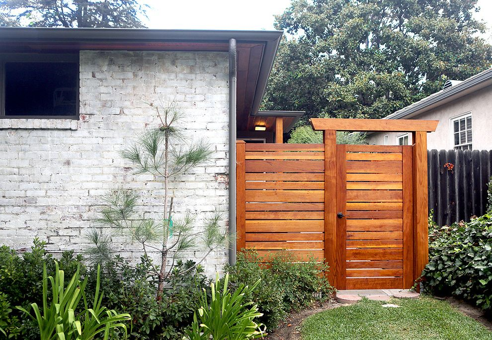 Pressure Mounted Dog Gates with Midcentury Landscape  and Clerestory Window Hip Roof Limewash Brick Post and Lintel Redwood Eaves Redwood Gate and Fence Whitewashed Brick Wooden Gate