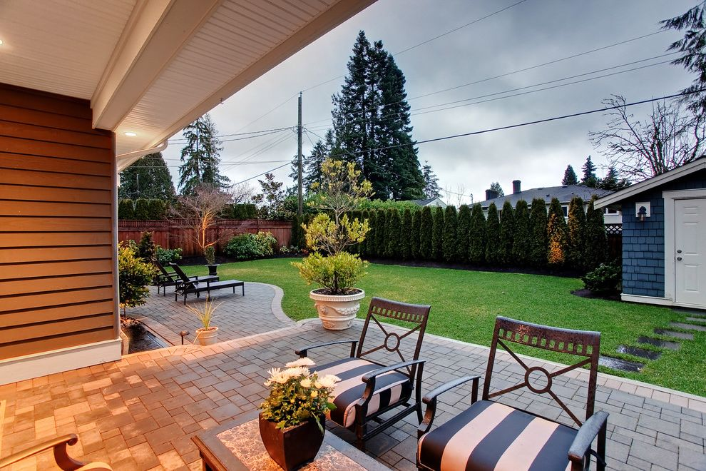 Privacy Fence Trees   Contemporary Patio  and Covered Patio Fence Lawn Lounge Chairs Outdoor Seating Pavers Siding Striped Cushions