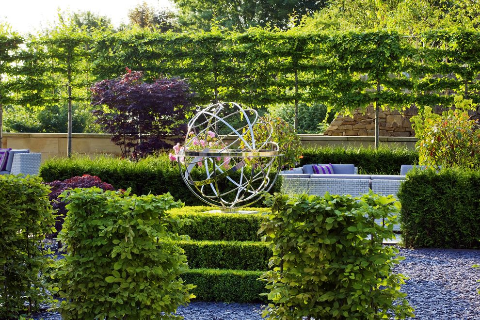 Privacy Fence Trees   Traditional Landscape  and Armillary Armillary Sphere Bushes Garden Hedges Outdoor Sectional Patio Furniture Pink Flowers Privacy Shrubs Sphere Stainless Steel Stone Wall Sundial Vines