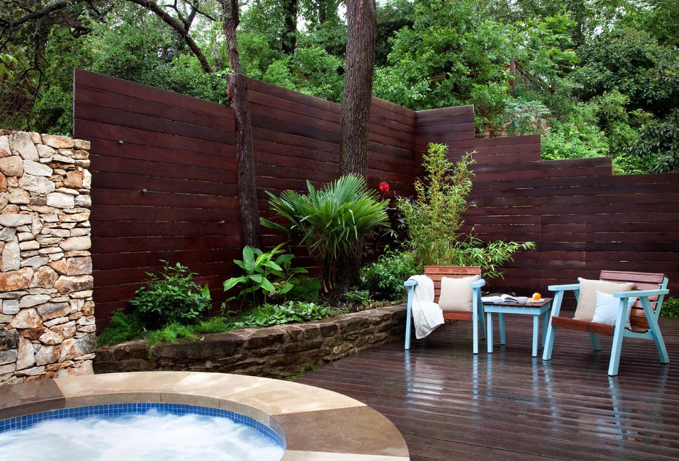 Privacy Fence Trees with Contemporary Patio Also Dark Stained Wood Elegant Light Blue Low Rock Wall Modern Mosaic Tile Partition Wall Patio Patio Furniture Planting Bed Private Retreat Spa Stacked Stone Stone Stonework Wood Slat