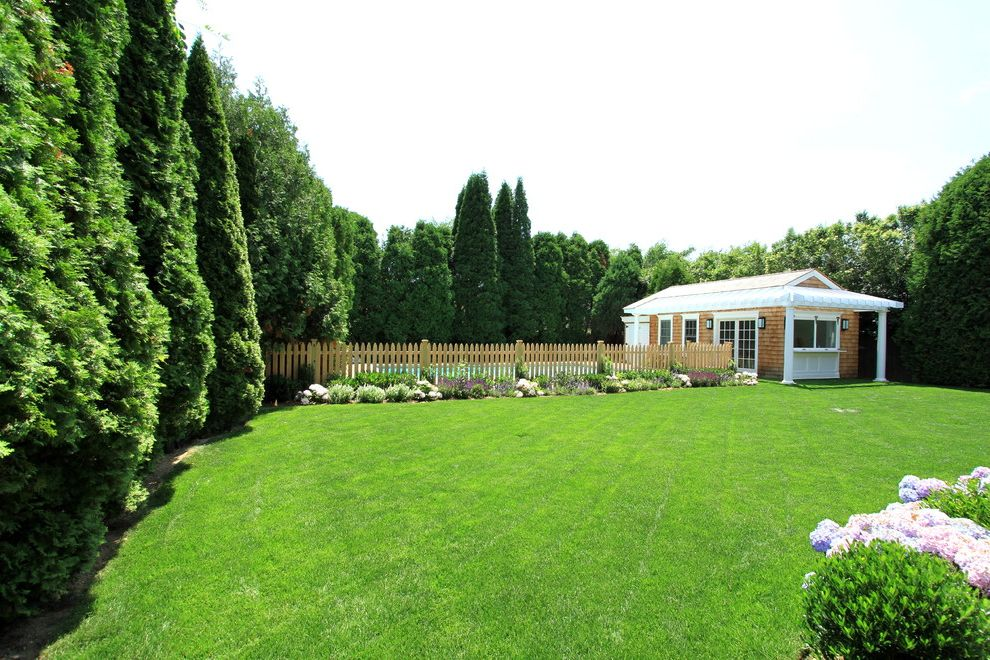 Privacy Fence Trees with Traditional Landscape Also Cedar Shingles Fence French Doors Gable Roof Landscaping Lawn Pergola Pool Wall Sconce White Painted Wood