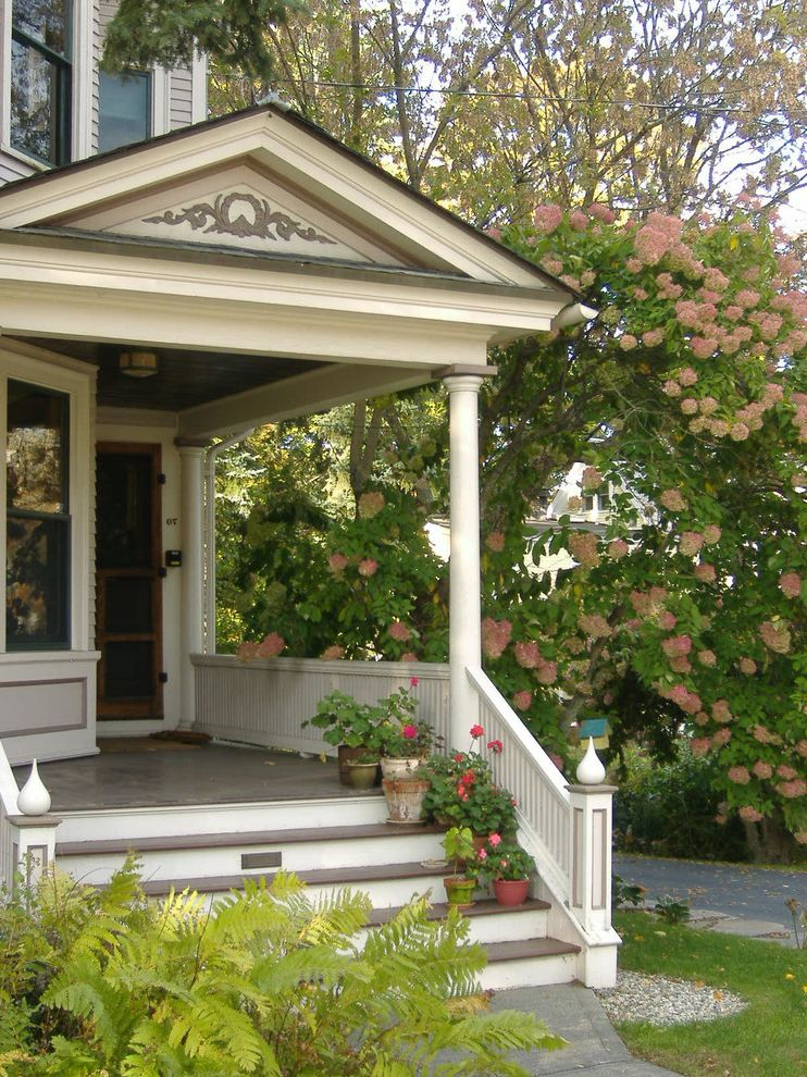 Privacy Fence Trees with Victorian Porch Also Columns Container Plants Door Entrance Entry Entryway Ferns Flowers Front Porch Front Steps Front Stoop House Numbers Porch Potted Plants Stairs Steps Victorian